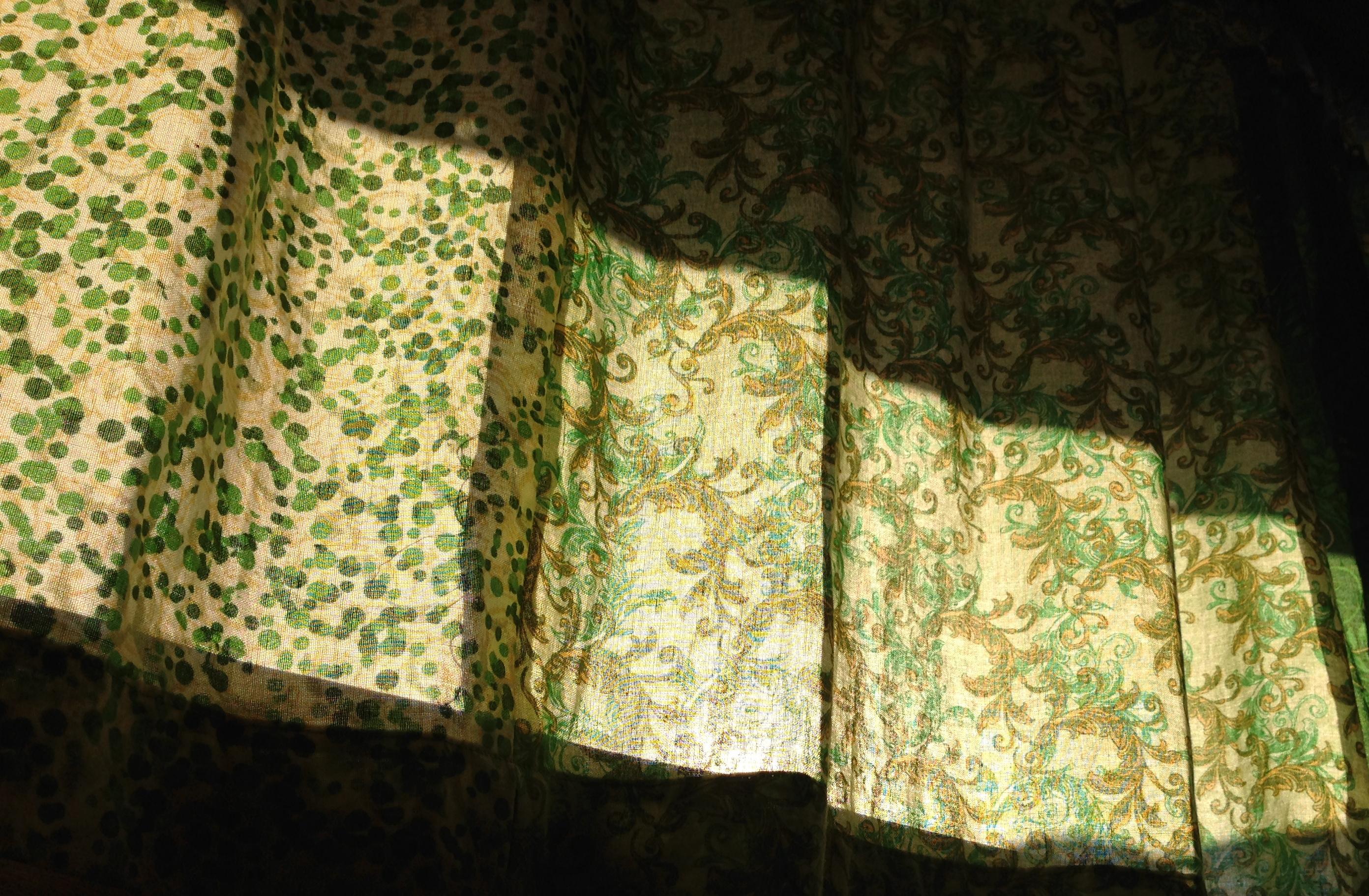 Sun shining through the curtains