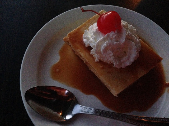 Flan with whipped cream & cherry