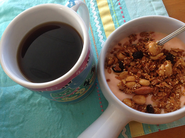 Coffee with peach yogurt and granola