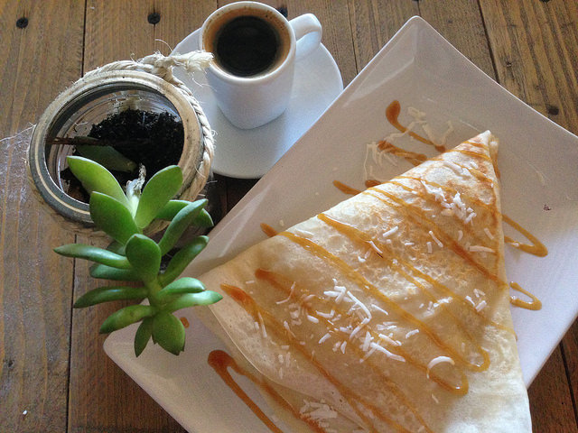 Mango crepe with caramel swirls and a shot of espresso