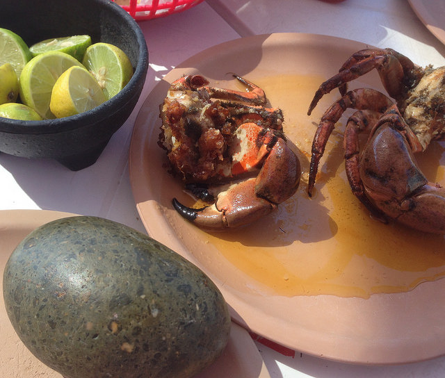 Crabs cooked in butter, complete with a stone to crack them with!